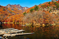 The autumn mountains and bamboo raft Royalty Free Stock Images