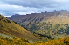 Autumn in the mountains of the North Caucasus. Rain clouds over the mountains of the North Caucasus, autumn  2015,Arkhyz, Karachay-Cherkessia, Russia Stock Photos