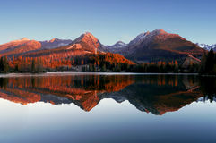 Autumn mountains with reflection in the lake Stock Image