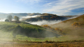 Autumn in the mountains - rural foggy landscape of high hills Stock Photography