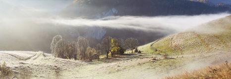 Autumn in the mountains - rural foggy landscape of high hills Stock Image