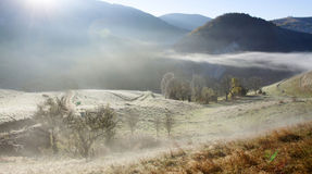 Autumn in the mountains - rural foggy landscape of high hills Stock Images