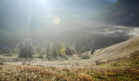 Autumn in the mountains - rural foggy landscape of high hills Stock Photos