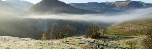 Autumn in the mountains - rural foggy landscape of high hills Royalty Free Stock Photo