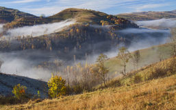 Autumn in the mountains - rural foggy landscape of high hills Royalty Free Stock Images