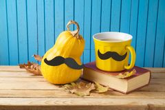 Autumn and Movember concept with coffee cup , pumpkin squash and Stock Images