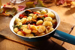 Autumn mushrooms served with Italian gnocchi Stock Photography