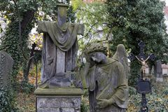 Autumn mystery old Prague Cemetery Olsany with its Statues, Czech Republic. Mystery old Prague Cemetery Olsany with its Statues, Czech Republic Royalty Free Stock Photography