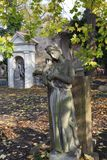 Autumn mystery old Prague Cemetery Olsany with its Statues, Czech Republic. Mystery old Prague Cemetery Olsany with its Statues, Czech Republic Stock Images