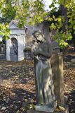 Autumn mystery old Prague Cemetery Olsany with its Statues, Czech Republic. Mystery old Prague Cemetery Olsany with its Statues, Czech Republic Stock Photos