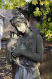 Autumn mystery old Prague Cemetery Olsany with its Statues, Czech Republic. Mystery old Prague Cemetery Olsany with its Statues, Czech Republic Royalty Free Stock Images