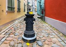 Autumn in narrow medieval street of old Riga Stock Image
