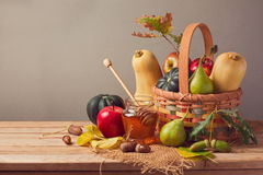 Autumn nature background. Fall fruits and pumpkin on wooden table. Thanksgiving table arrangement Royalty Free Stock Photo