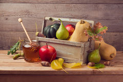Autumn nature composition. Fall fruits, pumpkin and honey on wooden table Stock Photography