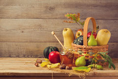 Autumn nature concept. Fall fruits and pumpkin on wooden table. Thanksgiving dinner. Set Stock Photo
