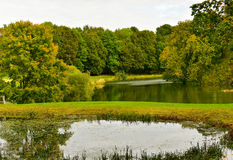 Autumn nature landscape. Golden colorful trees in autumn park with pond and lake Stock Photo