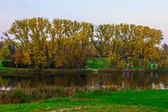 Autumn Nature with Trees and River in the Urban Park at Sunset Royalty Free Stock Photography