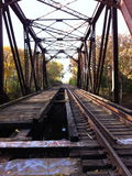 Autumn Near the Tracks. Train tracks running through a forest in autumn Stock Image
