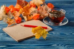 Autumn notes on blue table Royalty Free Stock Photo