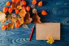 Autumn notes on blue table Stock Photos