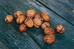 Autumn nuts. Some brown autumn nuts on a table Royalty Free Stock Images