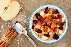 Autumn oats with apples and cranberries on vintage metal background Royalty Free Stock Images