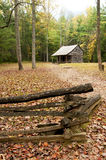 In autumn an old log cabin sits alone. Royalty Free Stock Photo