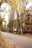 Autumn in the old town district. Autumn in the old area of the city, the house of the last century, tall trees, the atmosphere of quiet, calm and emptiness Royalty Free Stock Photo
