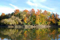 Autumn in Ontario. Photo of fall trees along the lake with reflective colors Royalty Free Stock Photos