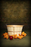 Autumn Orchard Basket. Fruit Basket adorned with fall leaves, can be used as a digital photography prop. with added apple stock photo
