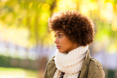 Autumn outdoor portrait of beautiful African American young woma Stock Photo