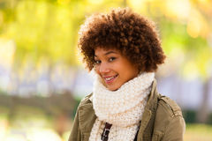 Autumn outdoor portrait of beautiful African American young woma Royalty Free Stock Images