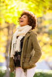 Autumn outdoor portrait of beautiful African American young woma Stock Image