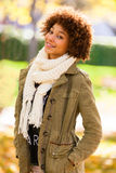 Autumn outdoor portrait of beautiful African American young woma Stock Photos