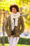 Autumn outdoor portrait of beautiful African American young woma Royalty Free Stock Photography