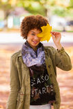 Autumn outdoor portrait of beautiful African American young woma Royalty Free Stock Photos