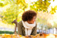 Autumn outdoor portrait of beautiful African American young woma Stock Photography