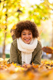 Autumn outdoor portrait of beautiful African American young woma Royalty Free Stock Photo