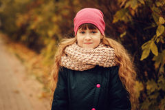 Autumn outdoor portrait of beautiful happy child girl walking in park or forest Royalty Free Stock Images