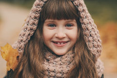 Autumn outdoor portrait of beautiful happy child girl walking in park or forest Stock Images