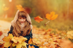 Autumn outdoor portrait of beautiful happy child girl walking in park or forest Royalty Free Stock Image
