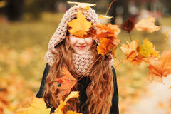 Autumn outdoor portrait of beautiful happy child girl walking in park or forest Stock Photos