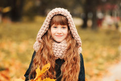 Autumn outdoor portrait of beautiful happy child girl walking in park or forest Royalty Free Stock Photos