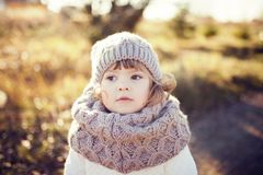 Autumn outdoor, toddler girl walking outdoors. Royalty Free Stock Image