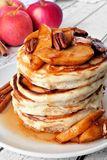 Autumn pancake stack with baked apples, pecans and cinnamon Stock Photos