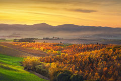 Autumn, panorama in Tuscany, rolling hills, woods and fields on Stock Image