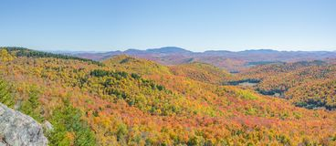Autumn Panoramic View Of The Adirondacks. Panoramic view of a landscape putting on its annual display of fall colors deep in the Adirondacks Royalty Free Stock Image