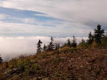 Autumn. Panoramic view at mountains above the clouds Royalty Free Stock Photo