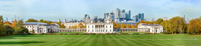 Autumn panoramic view to Greenwich park and Canary Wharf in Lond. London, UK - October 25, 2015: Autumn day in London Greenwich Park near Queen's House and the Royalty Free Stock Photography