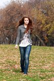 Autumn park. Beautiful young woman in autumn park Stock Photography